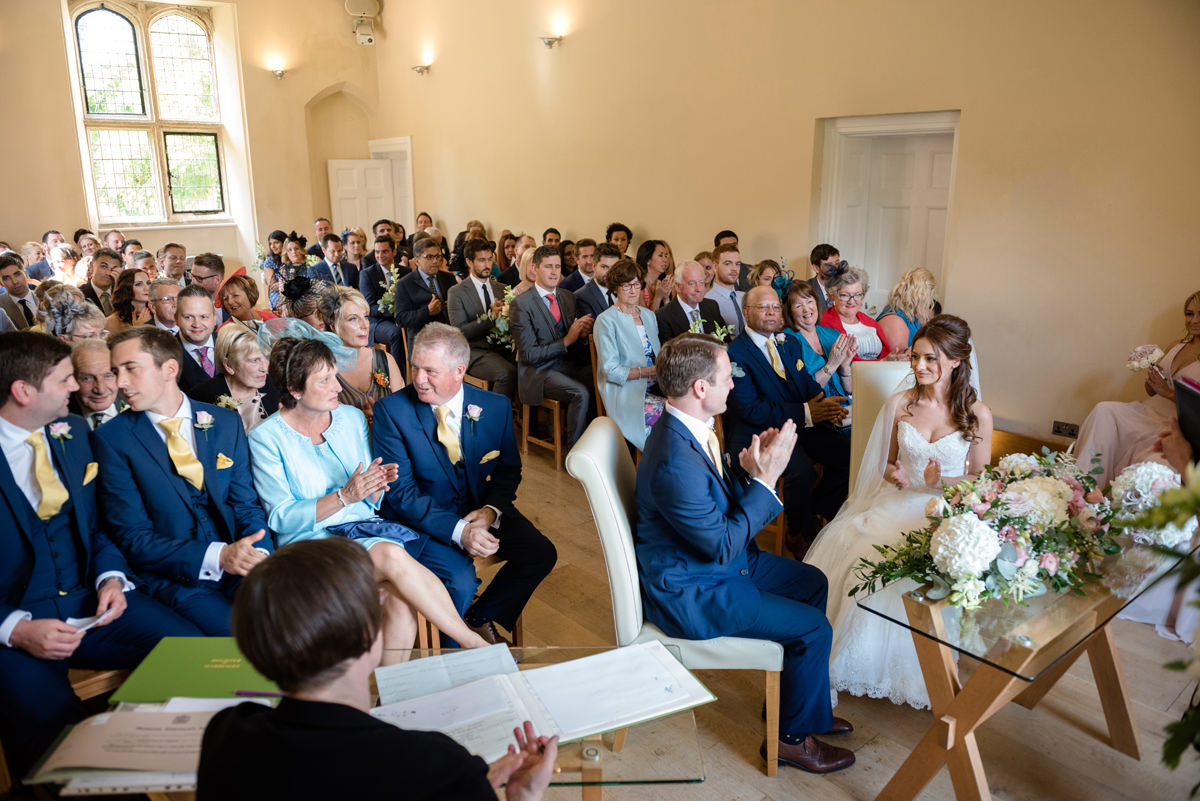 Guests clapping after a ceremony reading at Notley Abbey