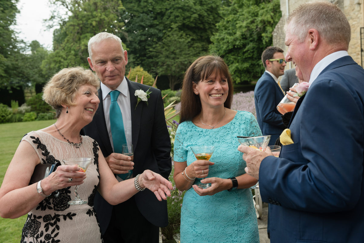 Guests chatting during the drinks reception at Notley Abbey