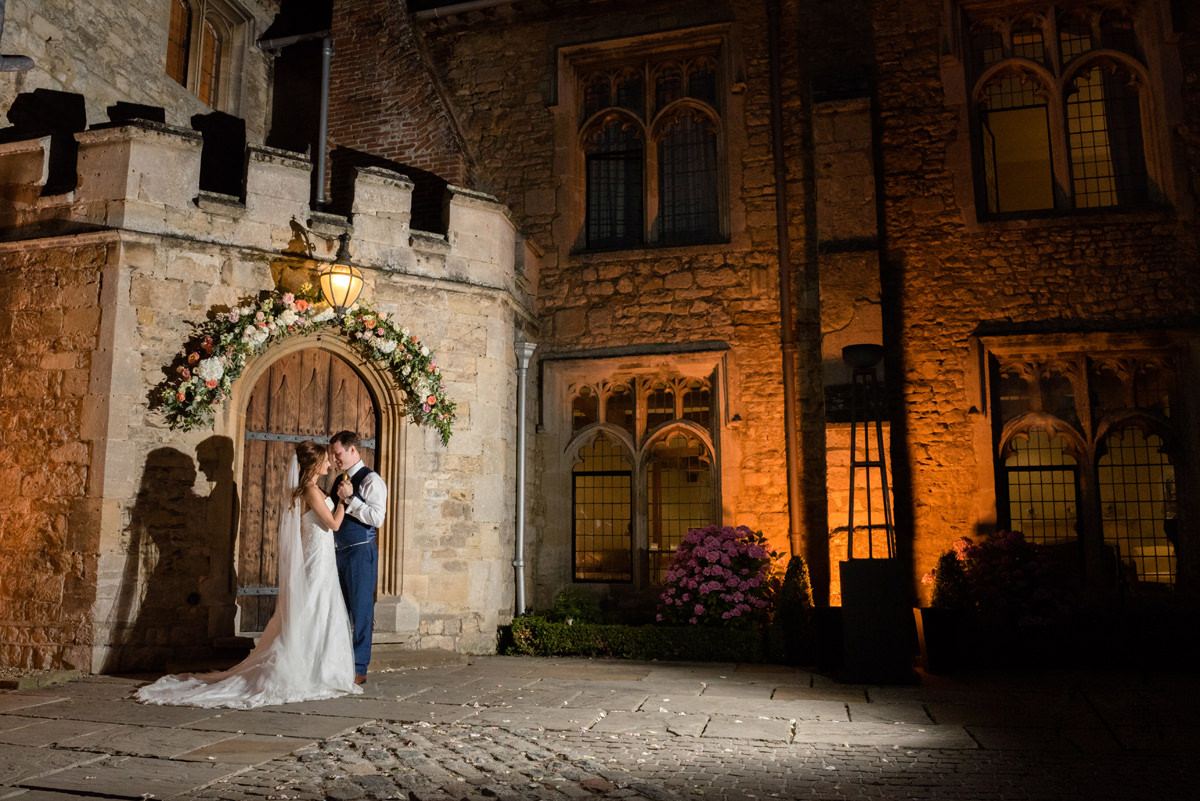 Night time shot of the bride and groom in front of Notley Abbey