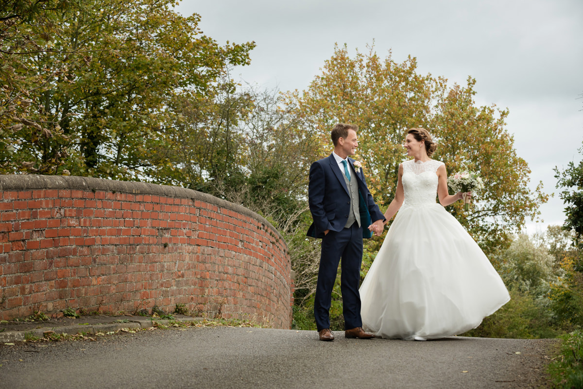 Bride and groom on the bridge at Dodmoor House