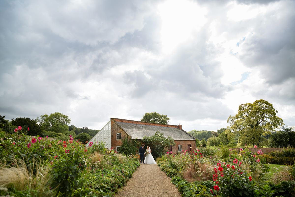 bride and groom in the walled garden at Kelmarsh Hall