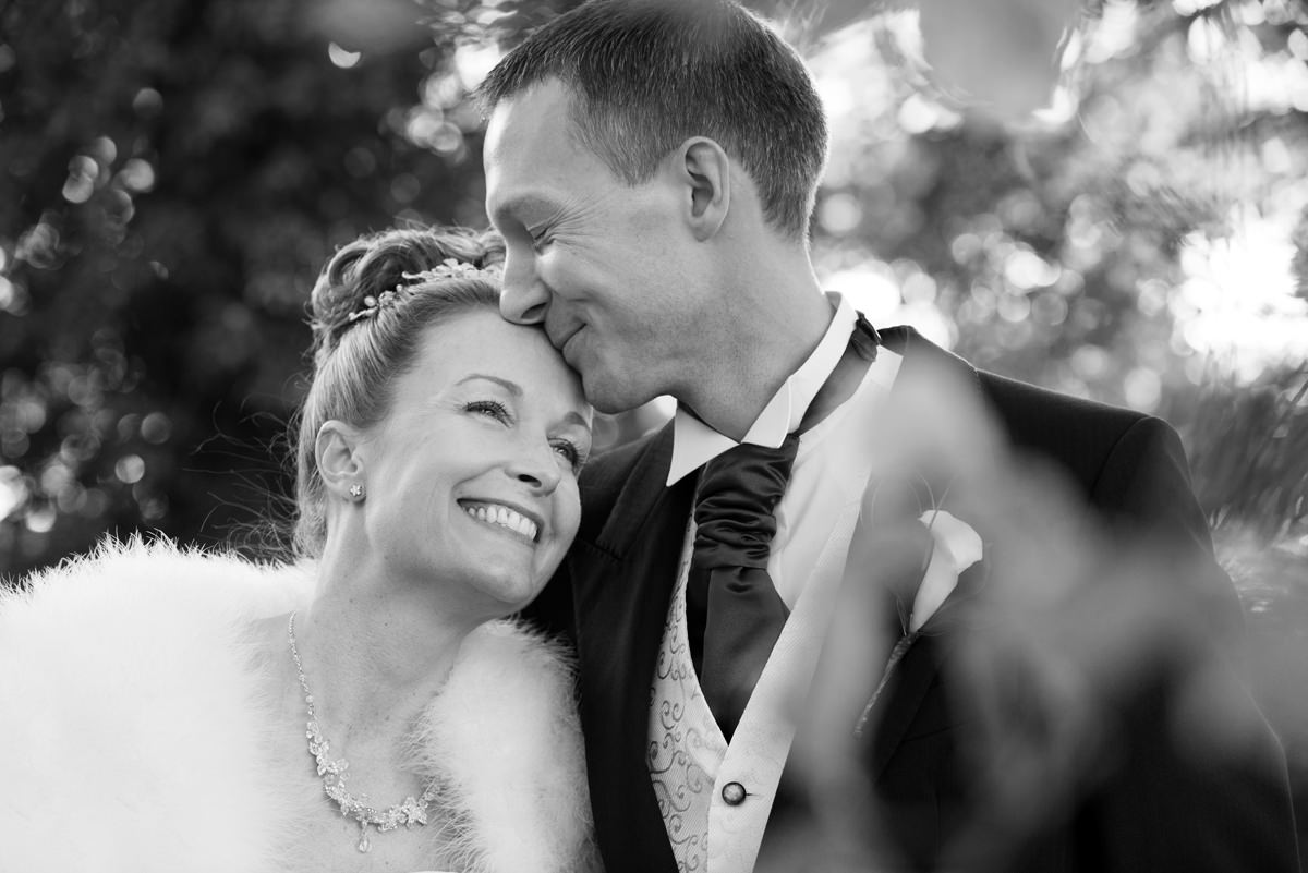 Romantic black and white portrait of a bride and groom