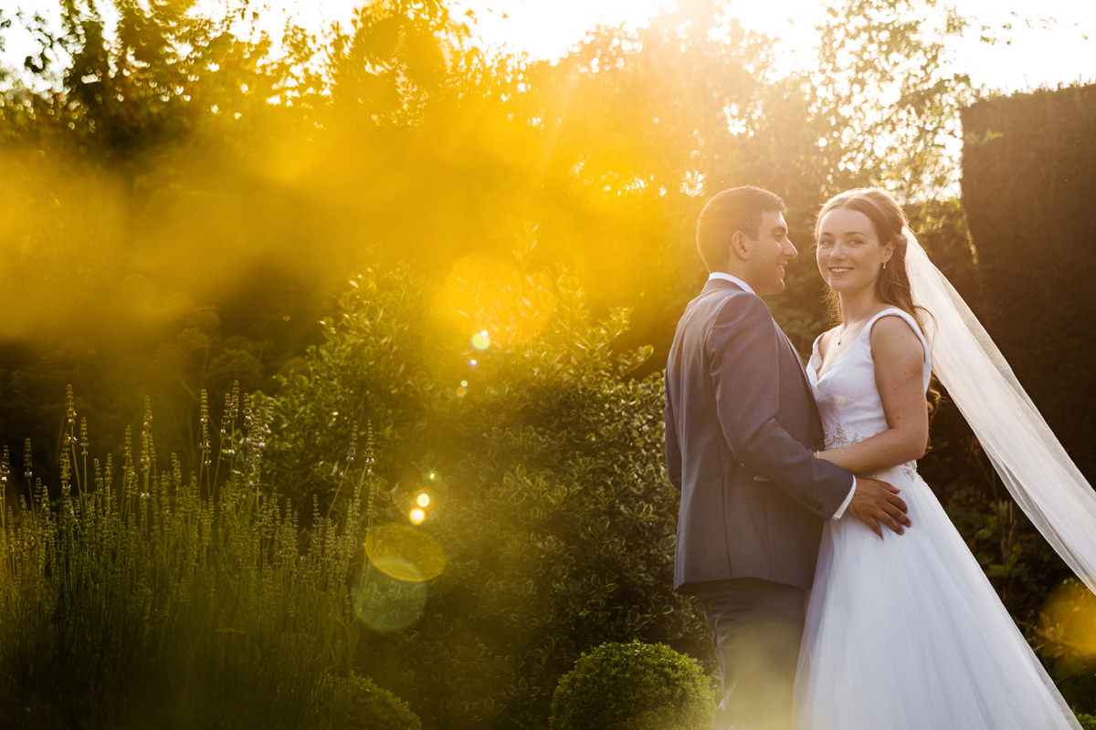 Portrait of bride and groom as the sun sets at Holdenby House
