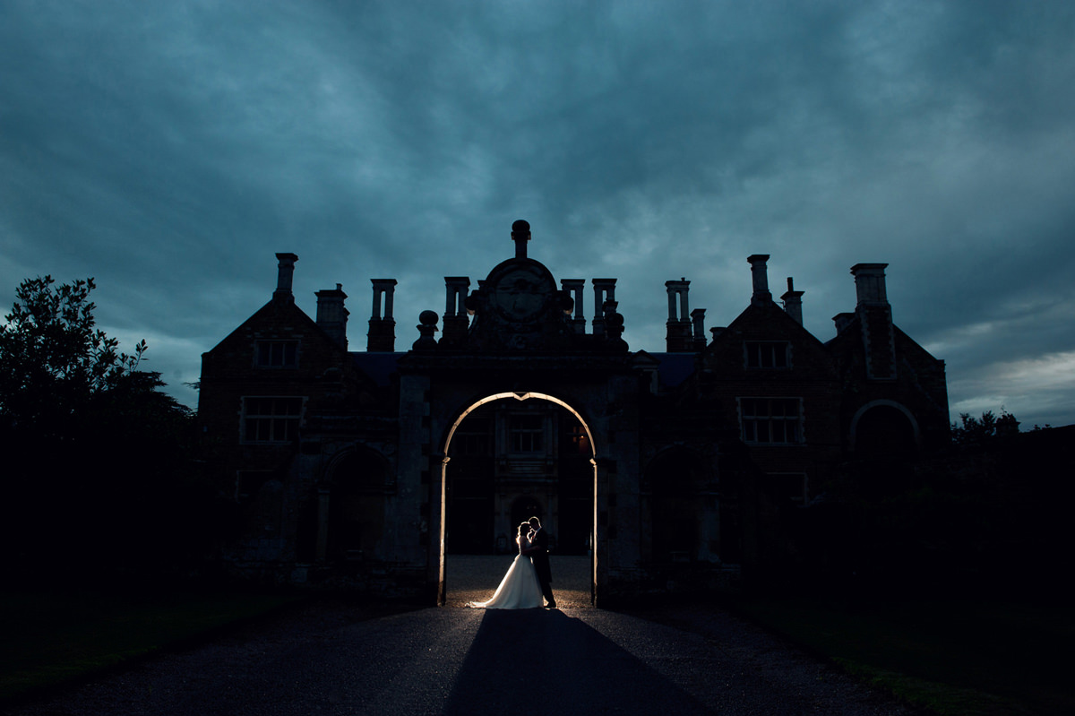 Dramatic photo of bride and groom during blue hour at Holdenby House