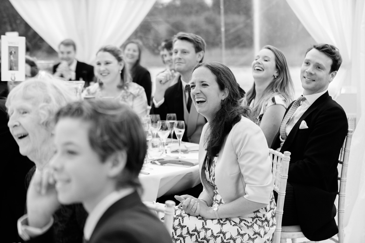 Wedding guests laughing at the speeches