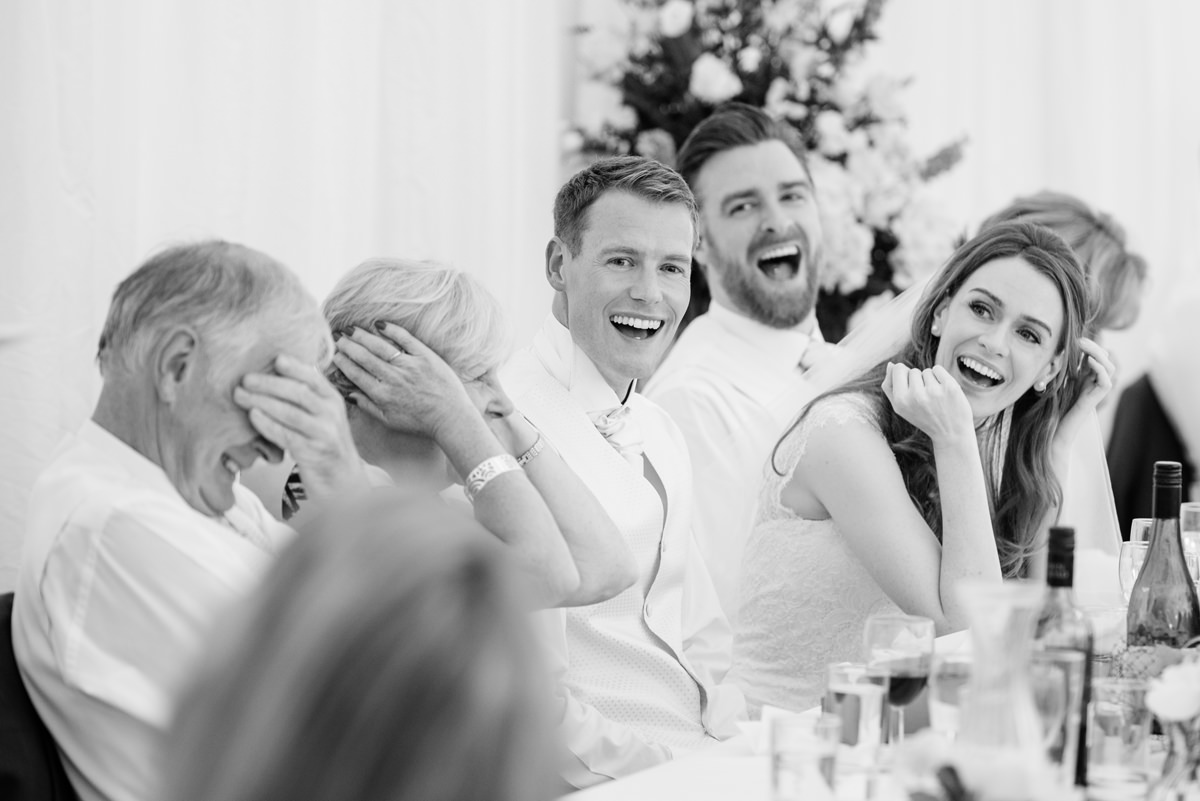 Parents of the groom cover their ears during the best man's speech