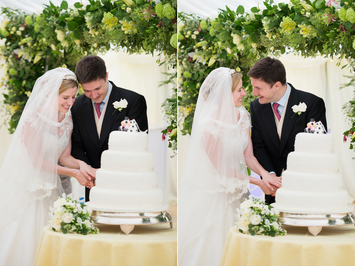 A classic cutting of the wedding cake photo