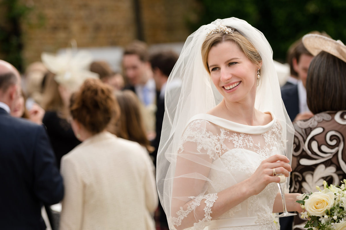 Bride smiling with a glass of champagne in her hand
