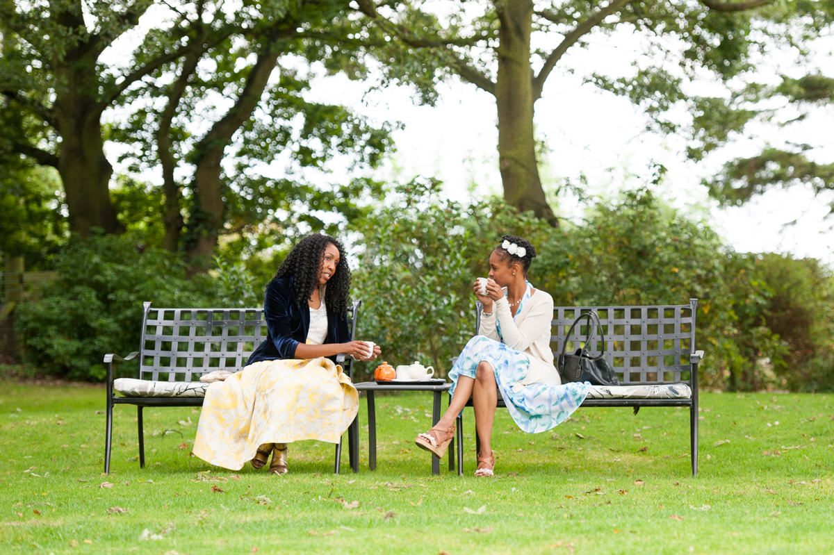 Jamaican wedding guests enjoying a cup of tea in the English countryside