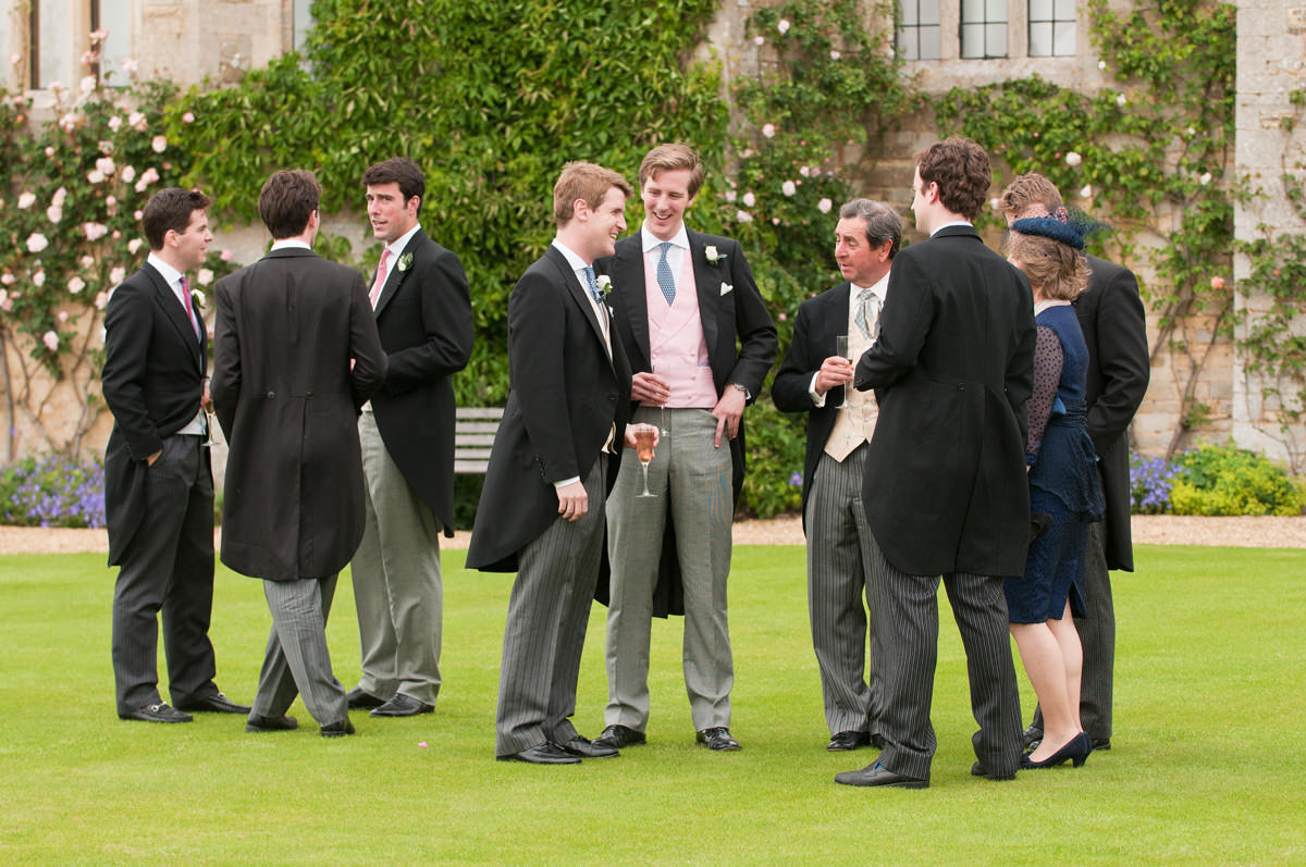 Wedding guests chatting during the drinks reception at Rockingham Castle