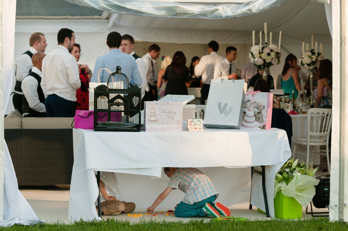 Two young boys playing games under the wedding gift table