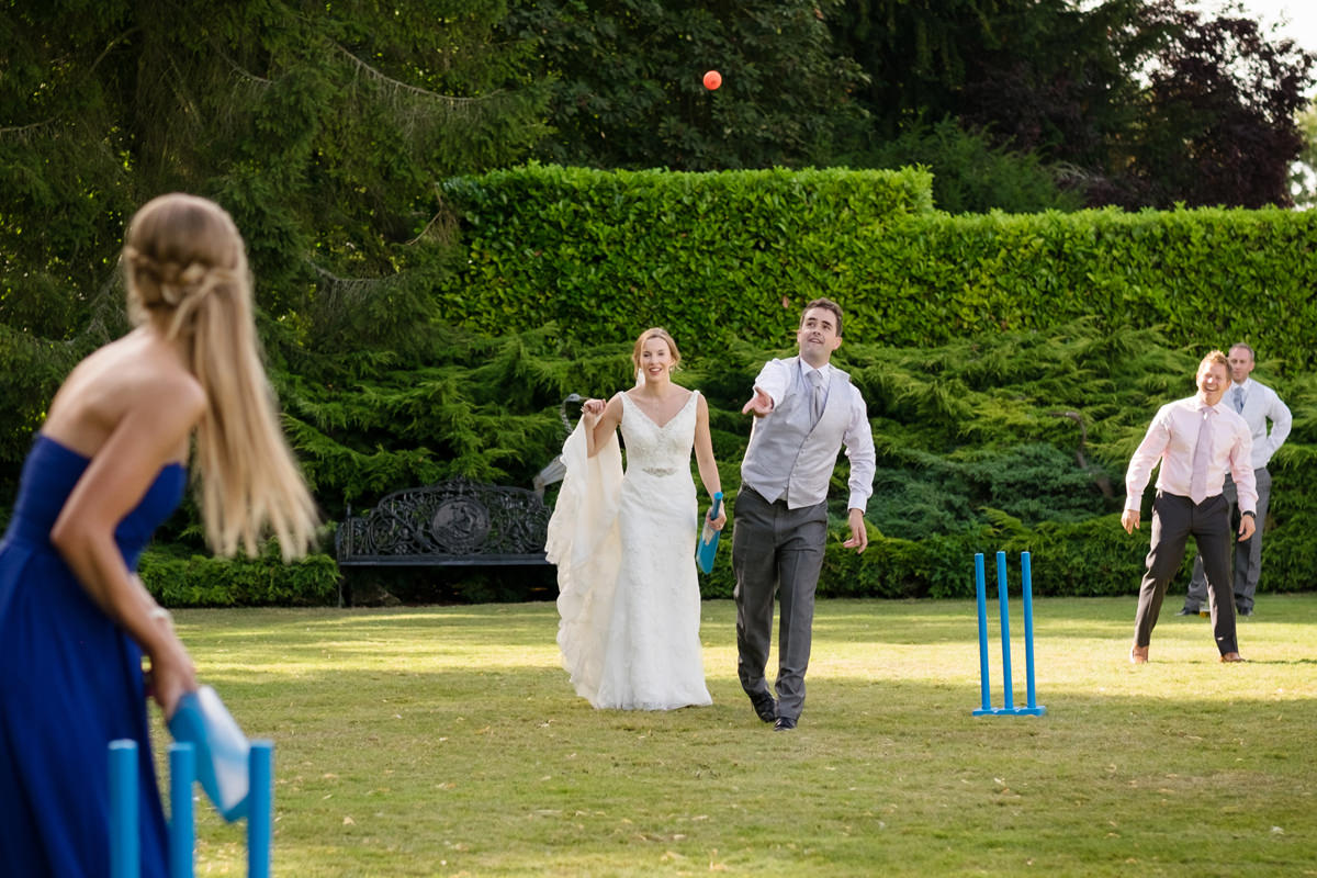 Wedding guests playgirl cricket during a drinks reception at Plum Park