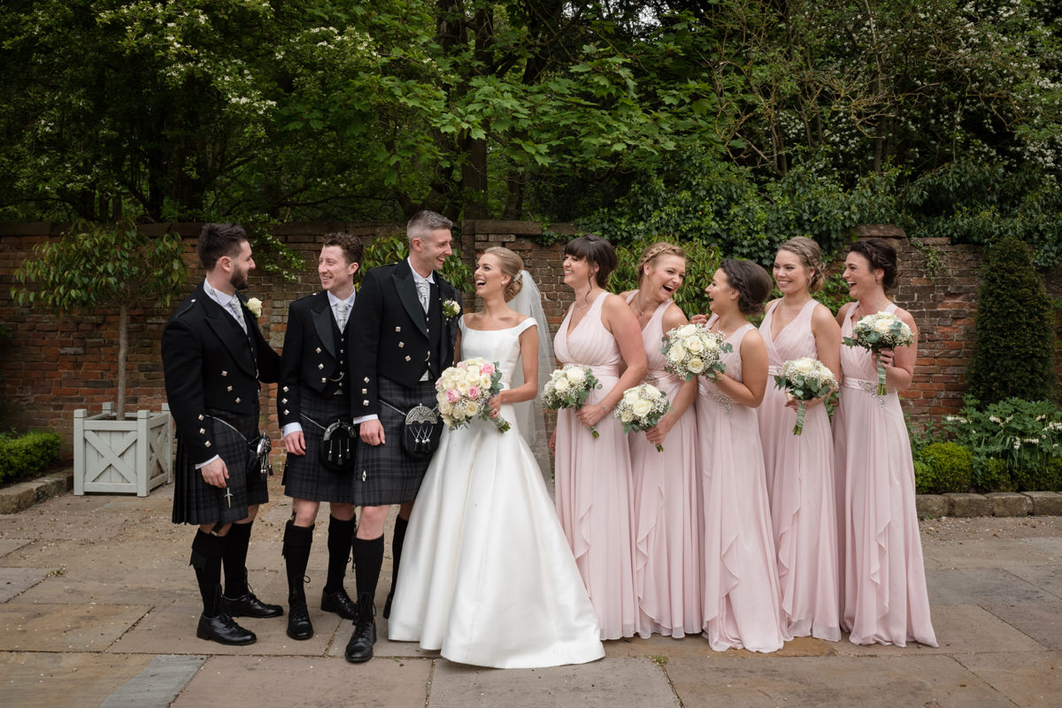 Bride and groom with their bridesmaids and best men
