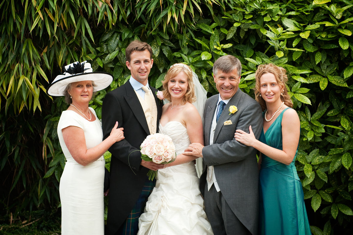 Bride and groom with groom's parents and sister