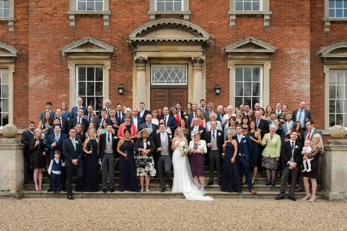 A photo of everyone on the front steps at Kelmarsh Hall