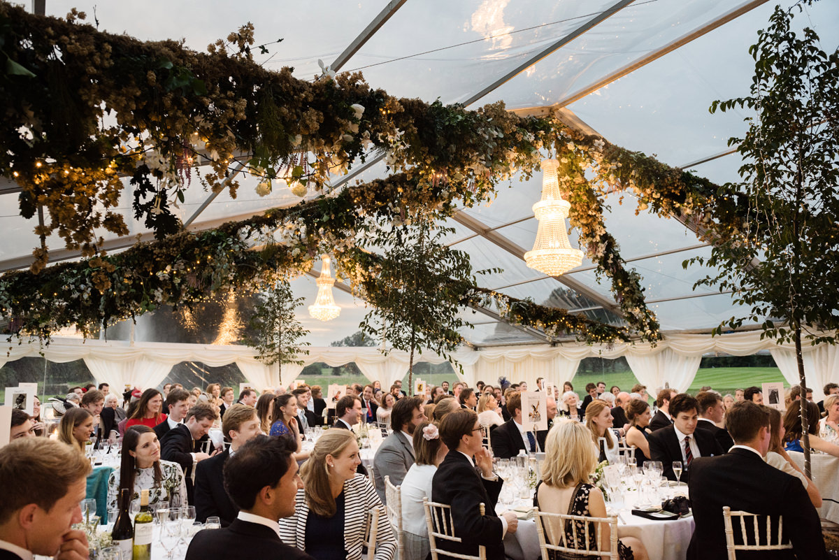 Speeches at dusk in a clear roof marquee