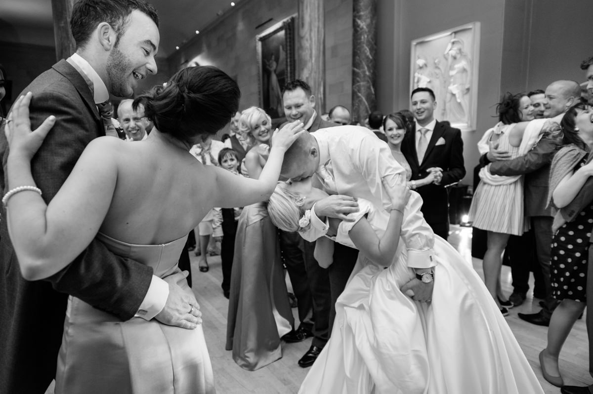 Groom dipping the bride at the end of their first dance at Woburn Abbey