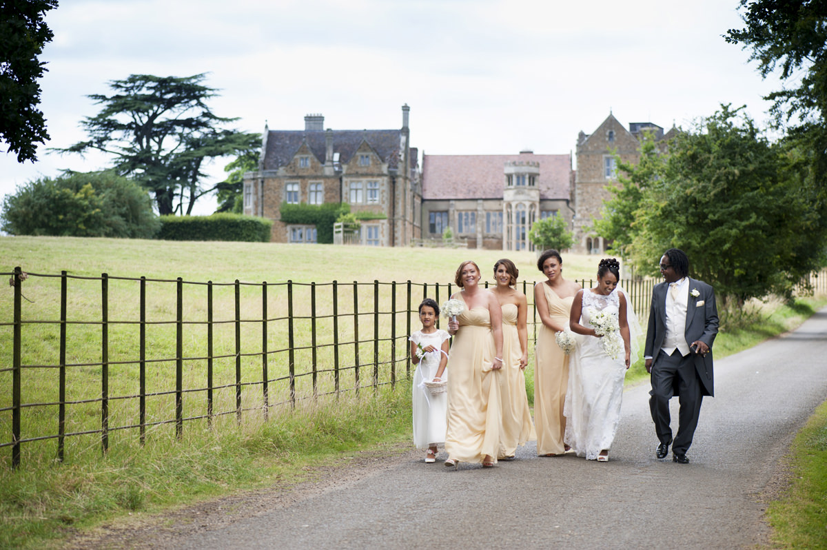 Bride walking to Fawsley church from Fawsley Hall