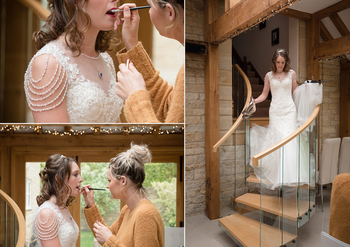 Bride coming down the stairs and having her lipstick done