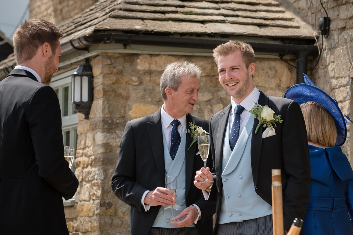 Groom enjoying a pre-ceremony drink at the The Kings Arms pub in Polebrook