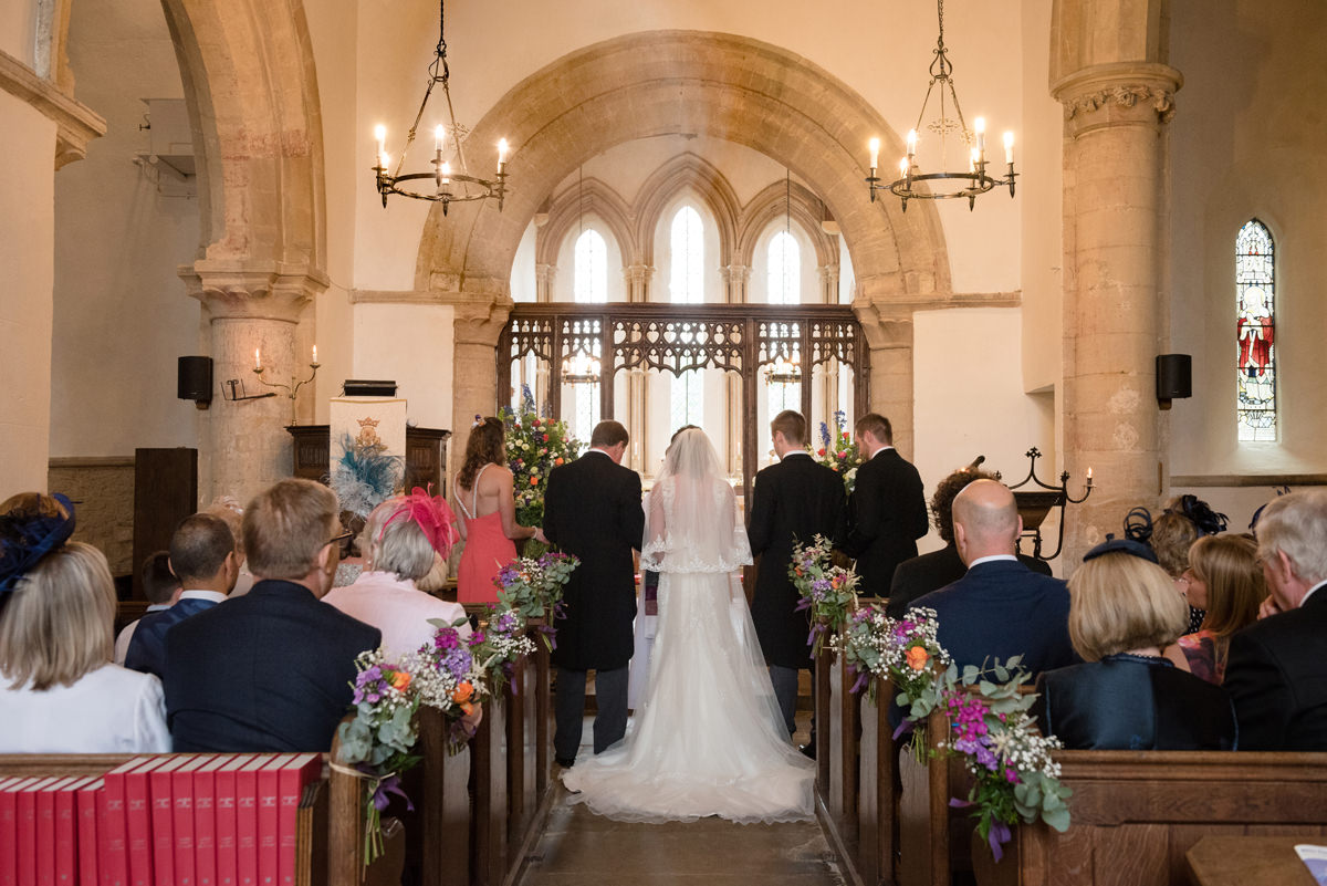 A wedding ceremony at All Saints church in Polebrook near Oundle