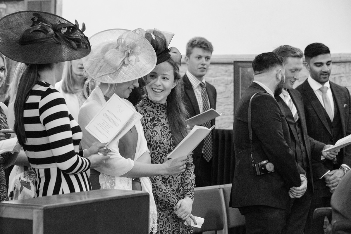 Wedding guests singing hymns at All Saints church in Polebrook near Oundle