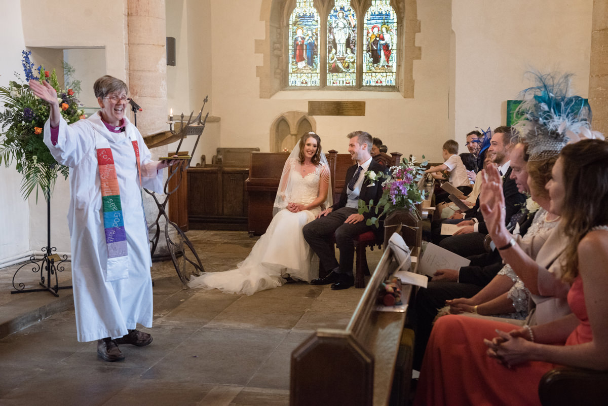 The vicar singing 'All you need is love' at All Saints church in Polebrook near Oundle