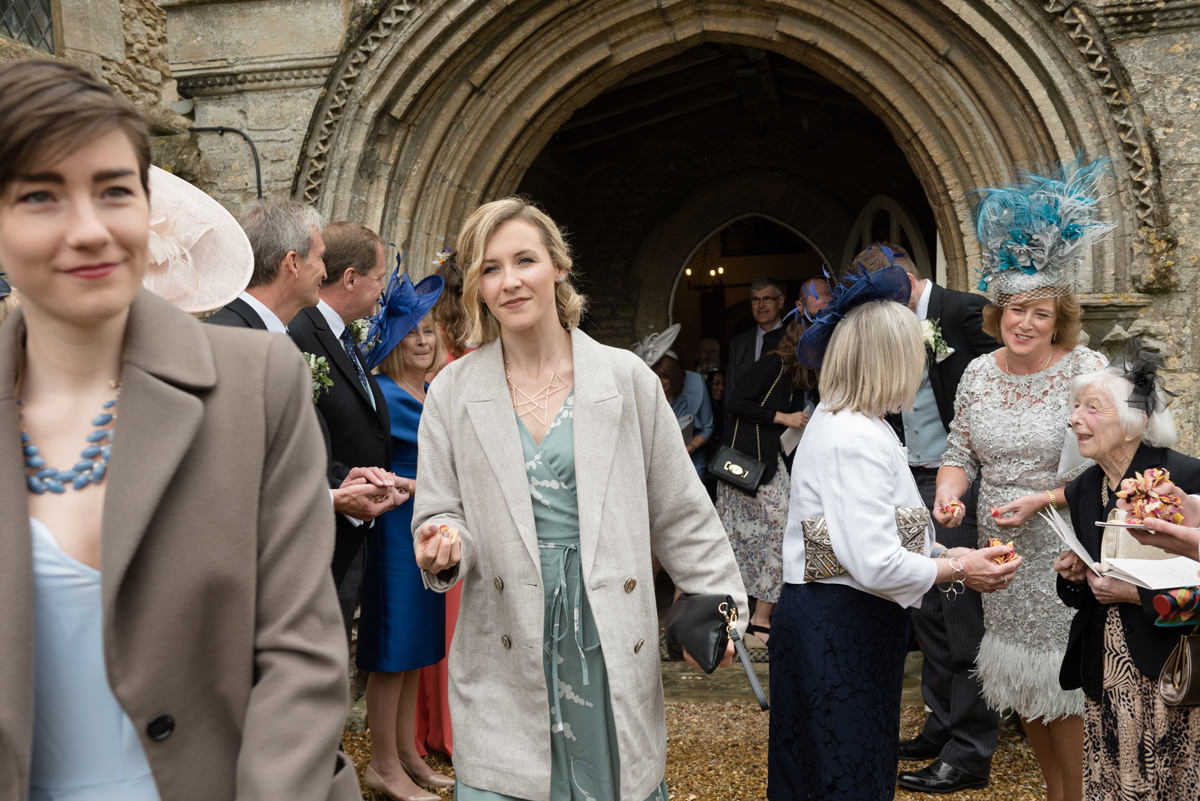 Wedding guests coming out of All Saints church in Polebrook near Oundle