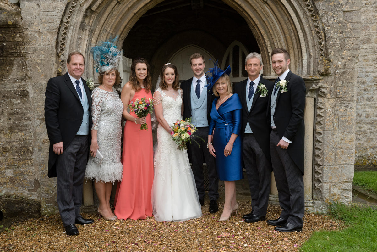 A family group photo outside All Saints church in Polebrook near Oundle
