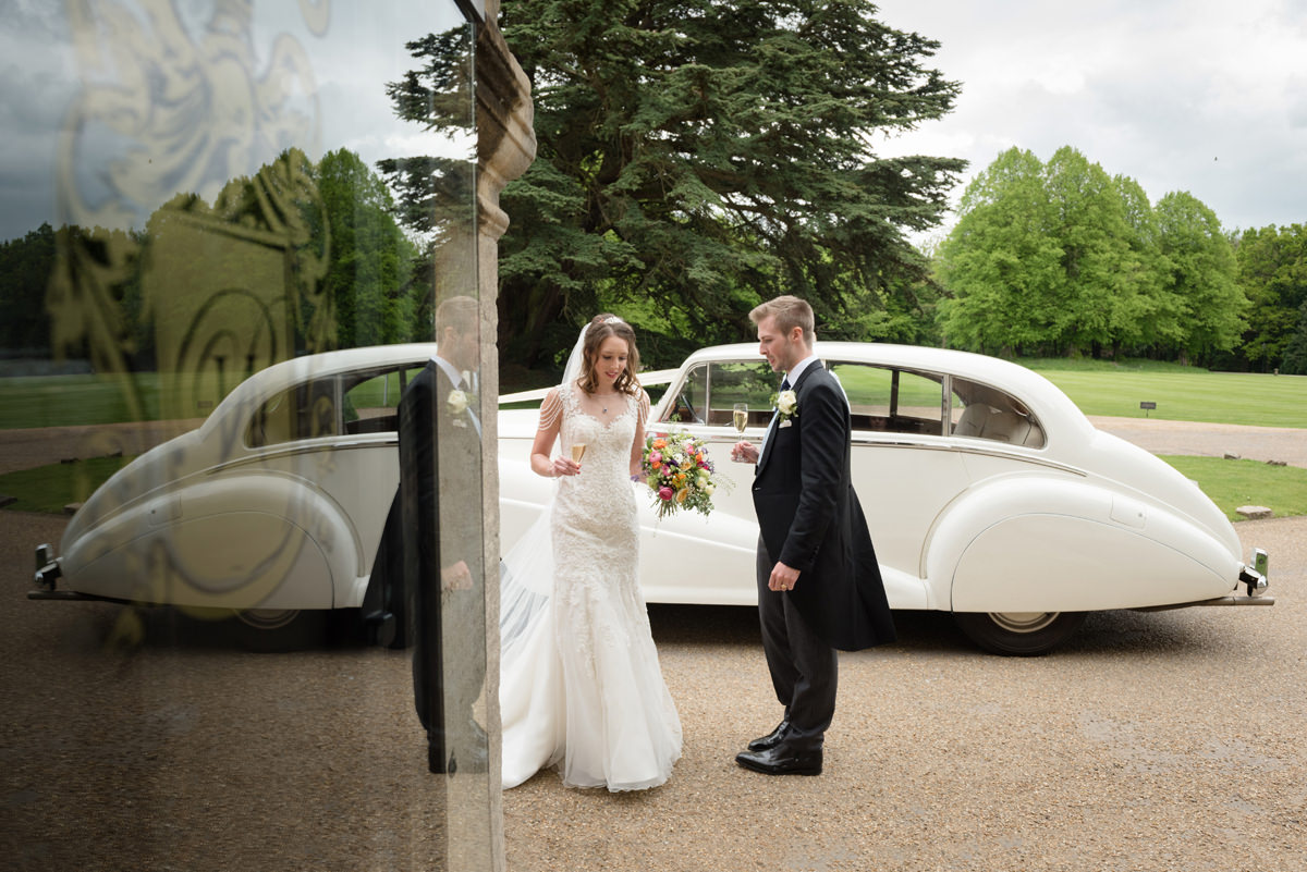 Bride and groom arriving at Rushton Hall in Kettering