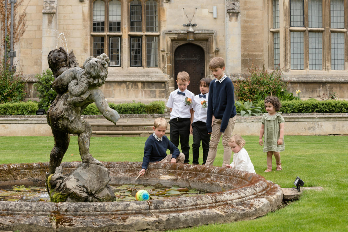 Children playing in the courtyard at Rushton Hall during the drinks reception