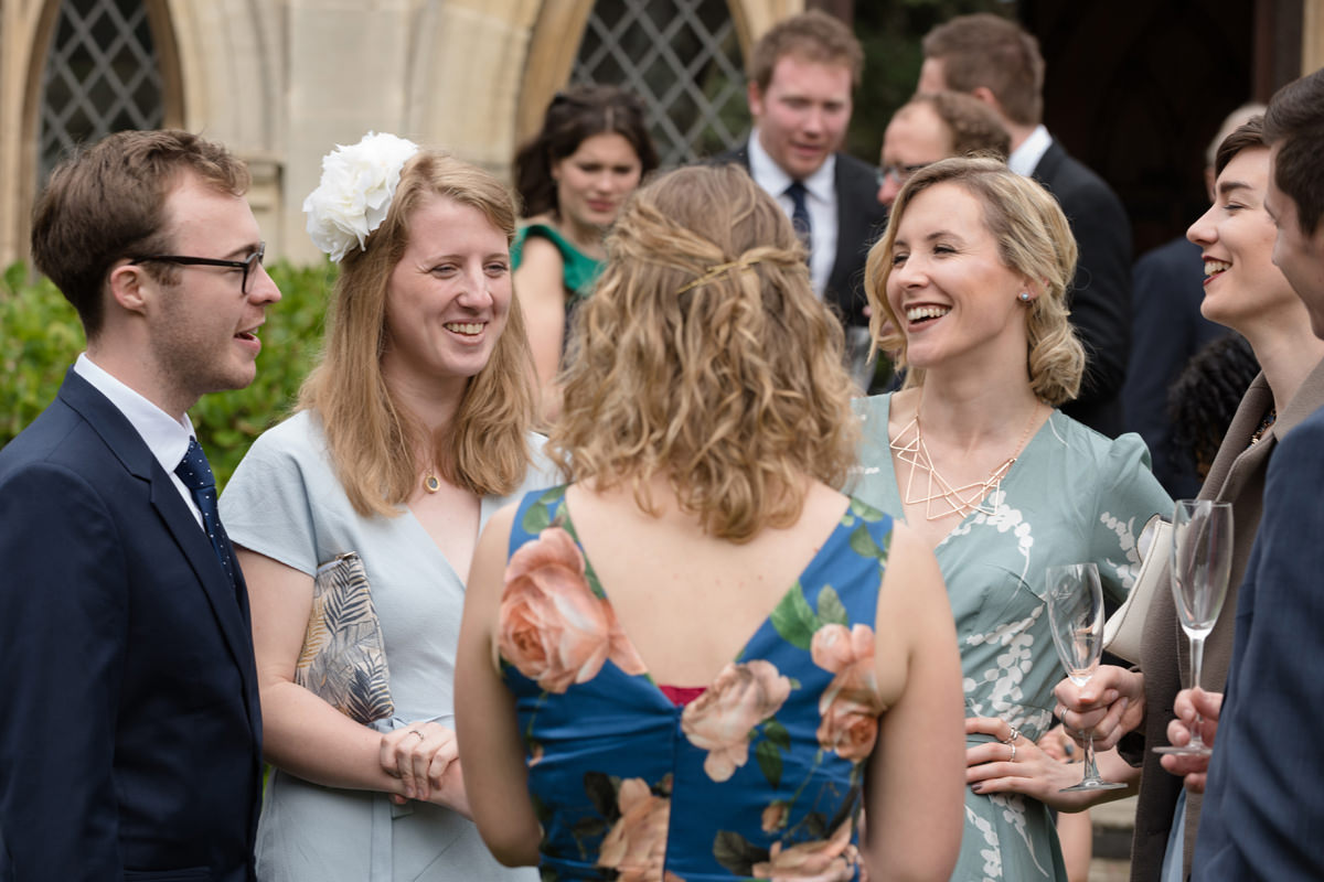 Wedding guests enjoy a drinks reception at Rushton Hall in Kettering
