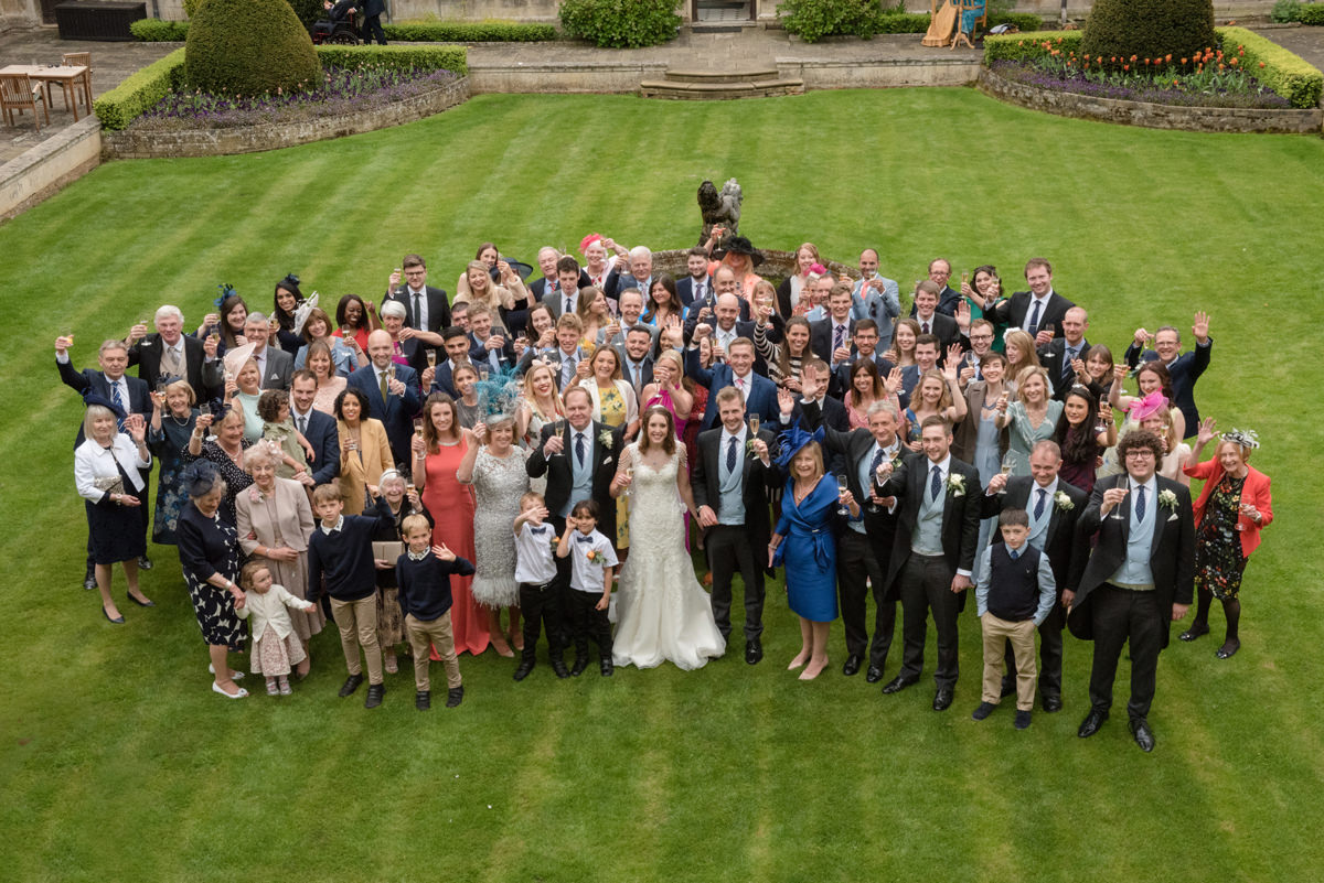 A photo of all the wedding guests at Rushton Hall in Kettering