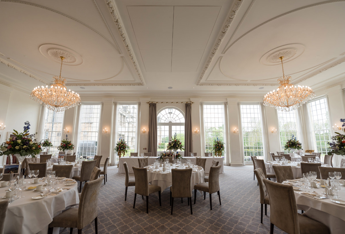 The ballroom set for the wedding breakfast in the orangery at Rushton Hall in Kettering