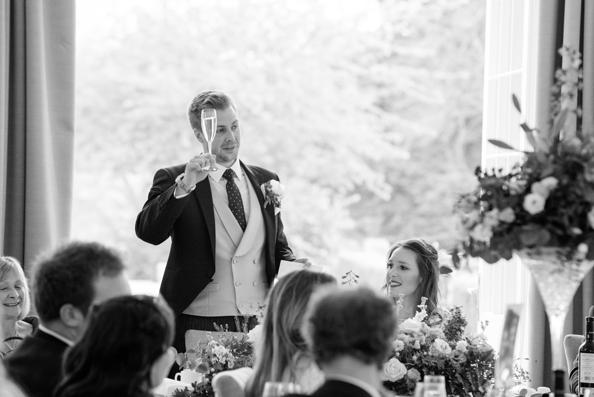 Groom making a toast at Rushton Hall in Kettering