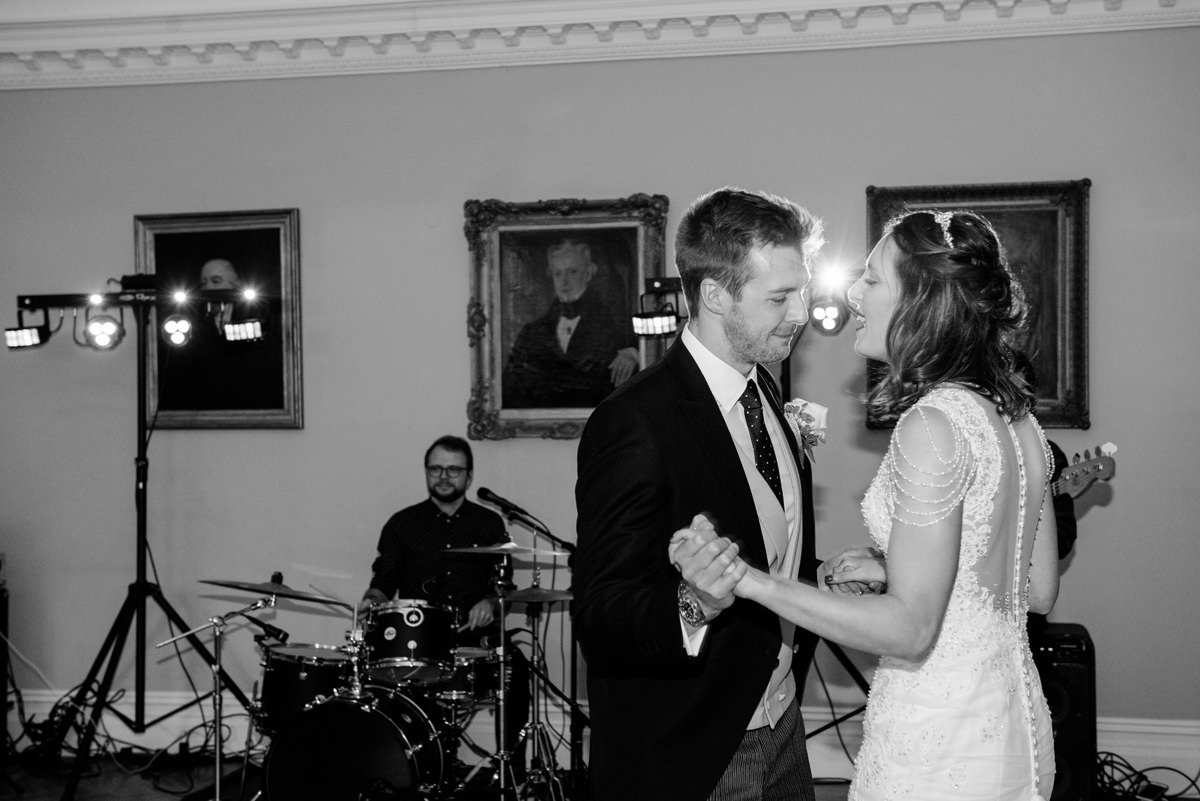 Bride and groom's first dance in the Picture Gallery at Rushton Hall in Kettering