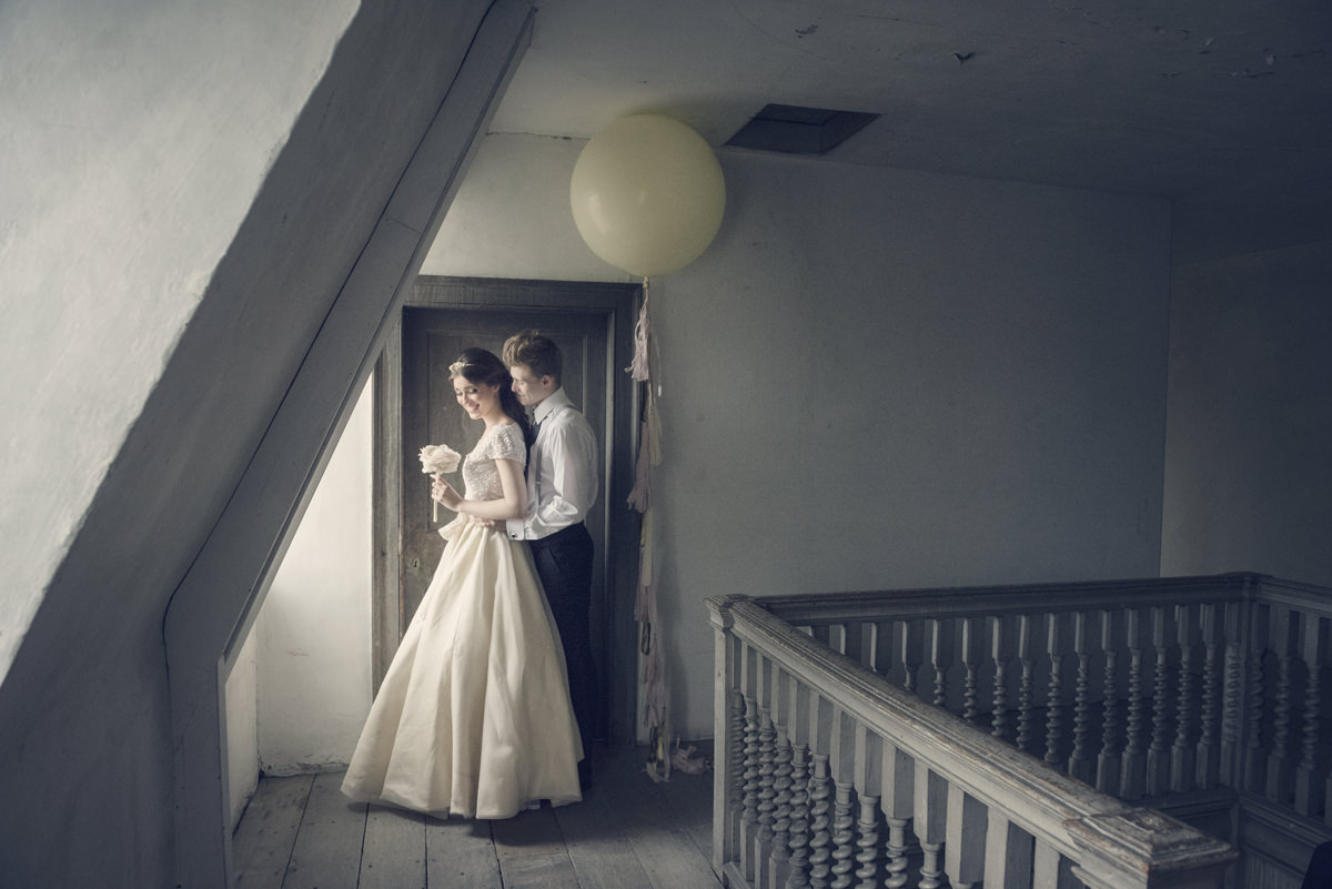 Bride and groom photo session in the attic at Boughton House