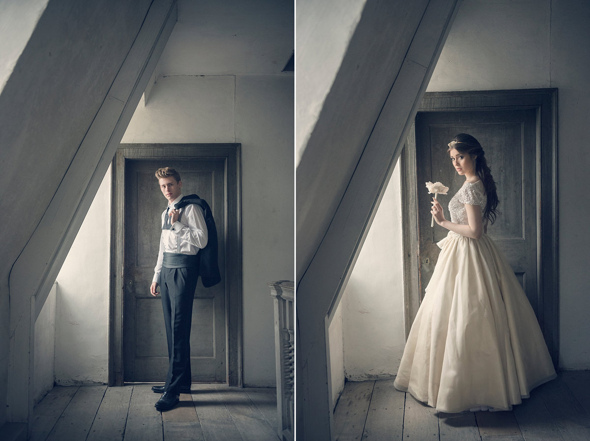 Wedding portraits by the window in the attic at Boughton House