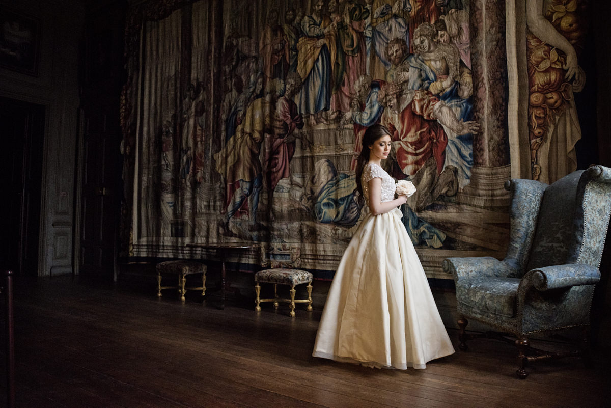 Bridal portrait with one of the tapestries at Boughton House