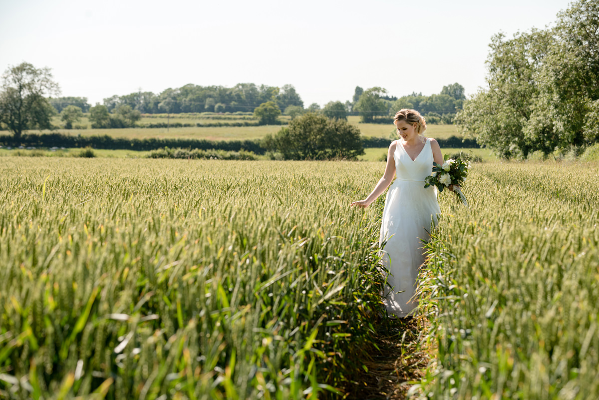 Bride in the cornfield at Sywell Grange in Northampton