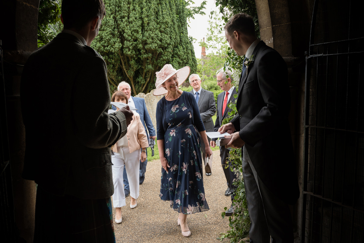Mother of the groom arriving at St Mary's church in Geddington, Northants