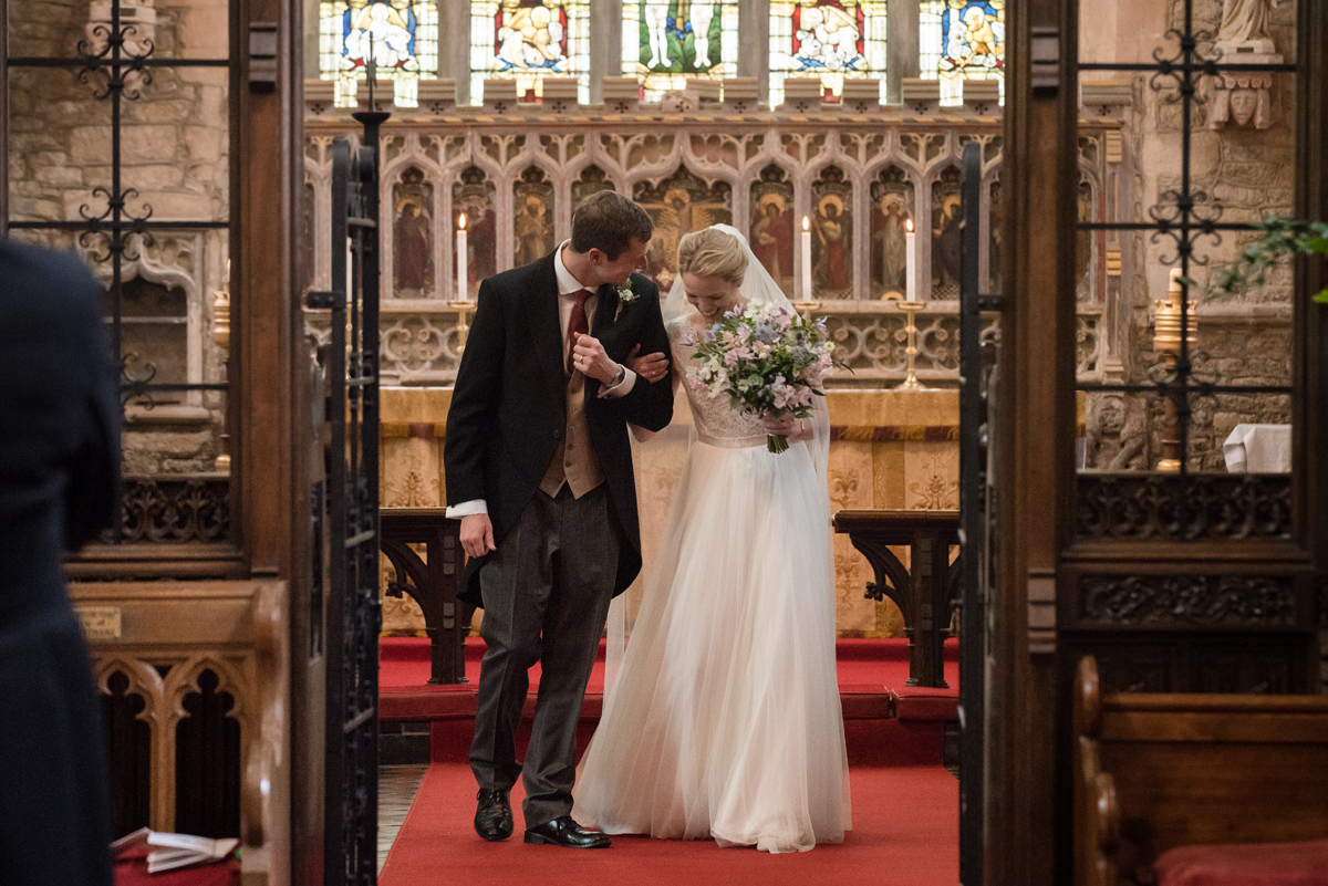 Wedding recessional at St Mary's church in Geddington, Northants