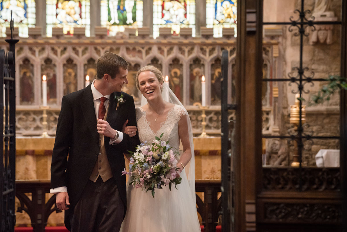 Newlyweds walking out of St Mary's church in Geddington, Northants