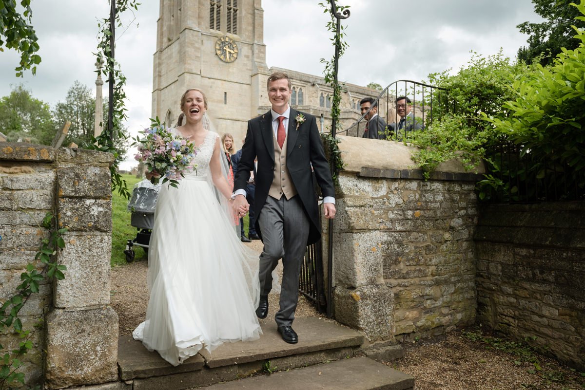 Bride and groom leaving St Mary's church in Geddington, Northants