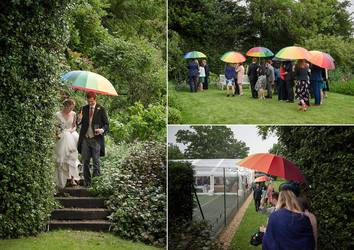 Rainbow umbrellas at a wet wedding in Geddington, Northamptonshire