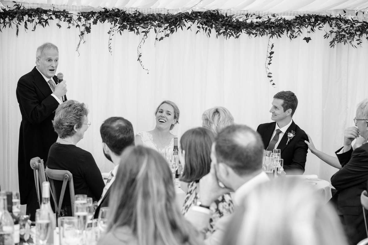 Father of the bride making a speech at a marquee wedding in Geddington, Northants