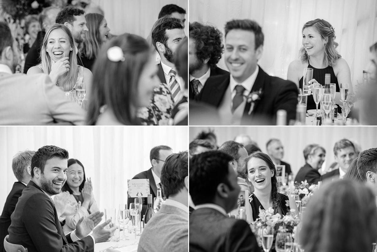 Guests laughing at the speeches at a marquee wedding in Geddington, Northants