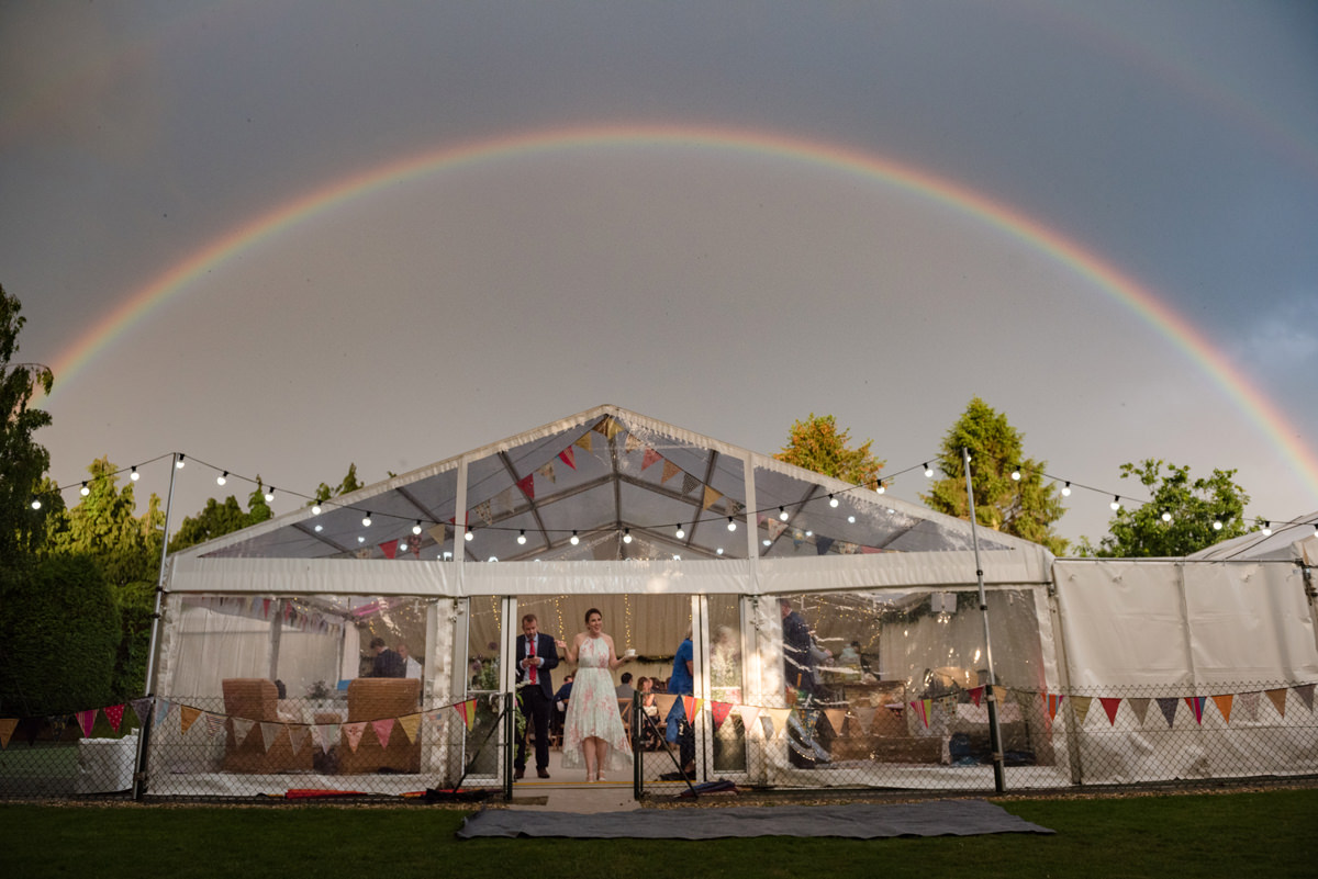 Rainbow over the marquee at a wedding in Geddington, Northamptonshire