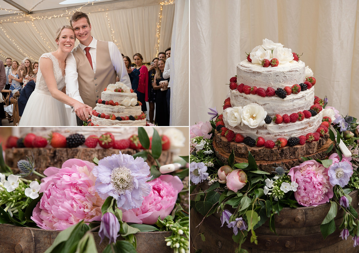 Bride and groom cutting their cake at a marquee wedding in Geddington, Northants