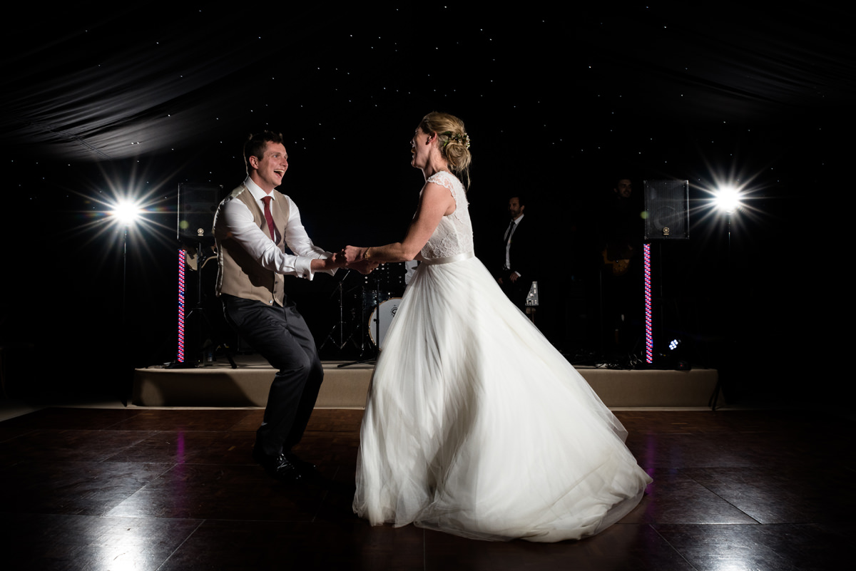 Bride and groom's first dance at a marquee wedding in Geddington, Northants